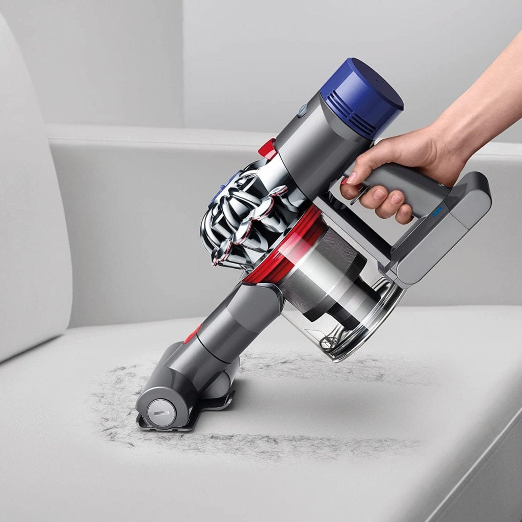 Vacuuming dog hair off the couch with Dyson V7